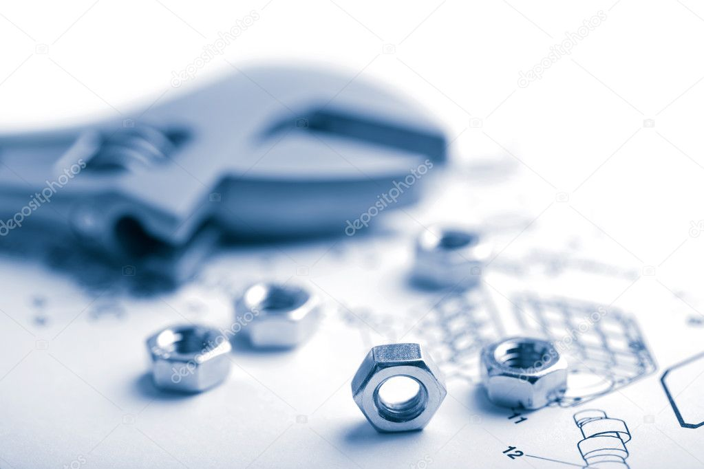 Wrench And Nuts Over Technical Drawing Stock Photo C Duskbabe 1468446