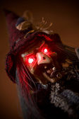 Fotografie Witch puppet with red glowing eyes