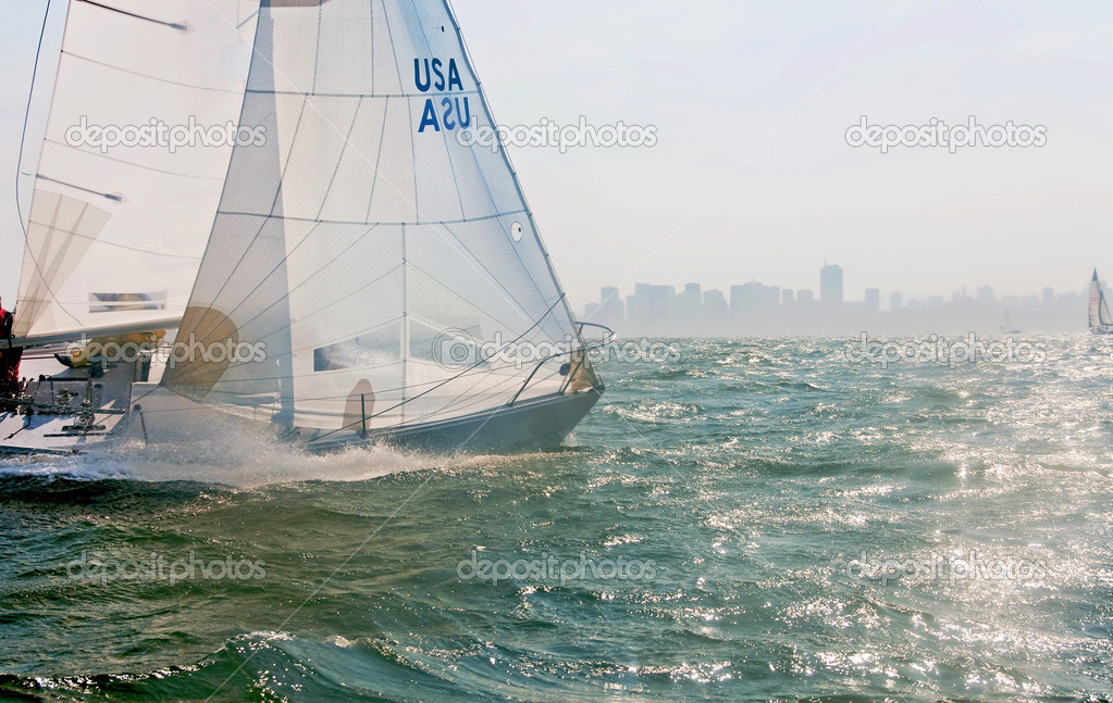 A sailboat racing on the bay