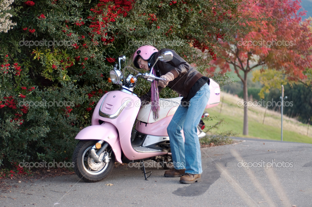 Woman turning on/off her motorbike