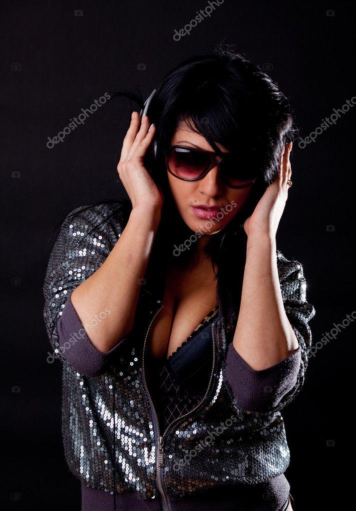 Attractive brunette listening music