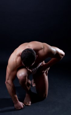 Picture of athletic man on his knees