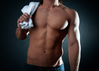 Male holding towel on his shoulder