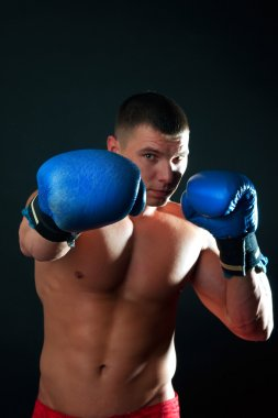 Athletic boxer during fighting