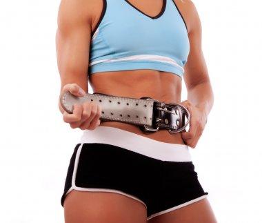 Sportswoman fastening her belt