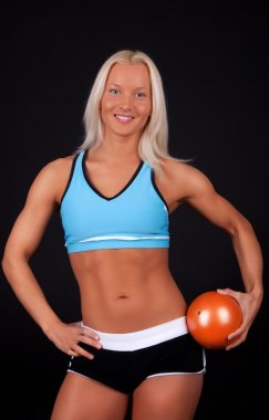 Smiling blonde with fitness ball