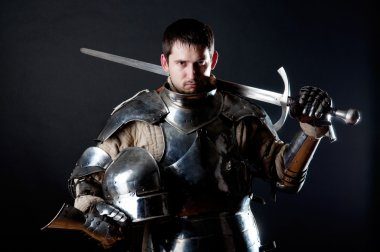 Knight holding sword and helmet
