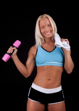 Sportswoman posing with dumbbells