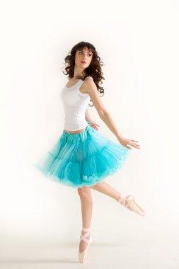 Young beautiful ballerina dances