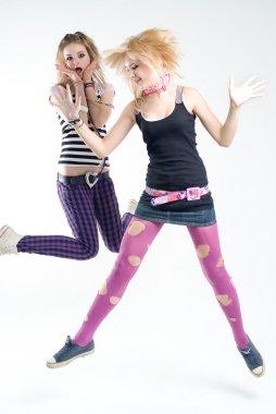 Two jumping punk girls