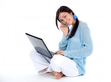 Girl with cellphone and laptop