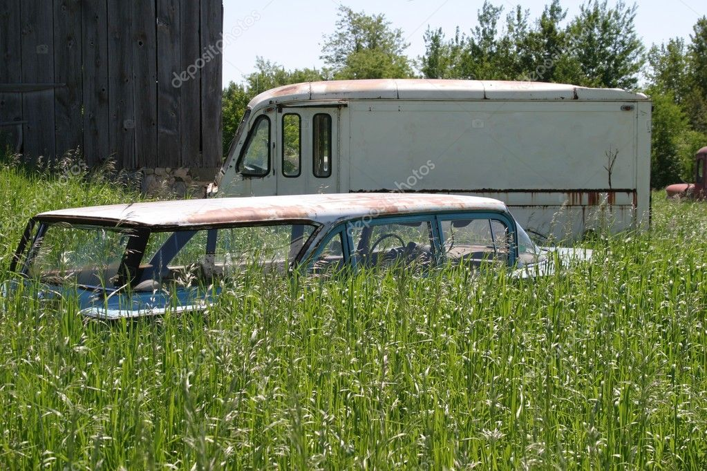 Old car and truck in tall grass — Stock Photo © jodygary97 #1505233