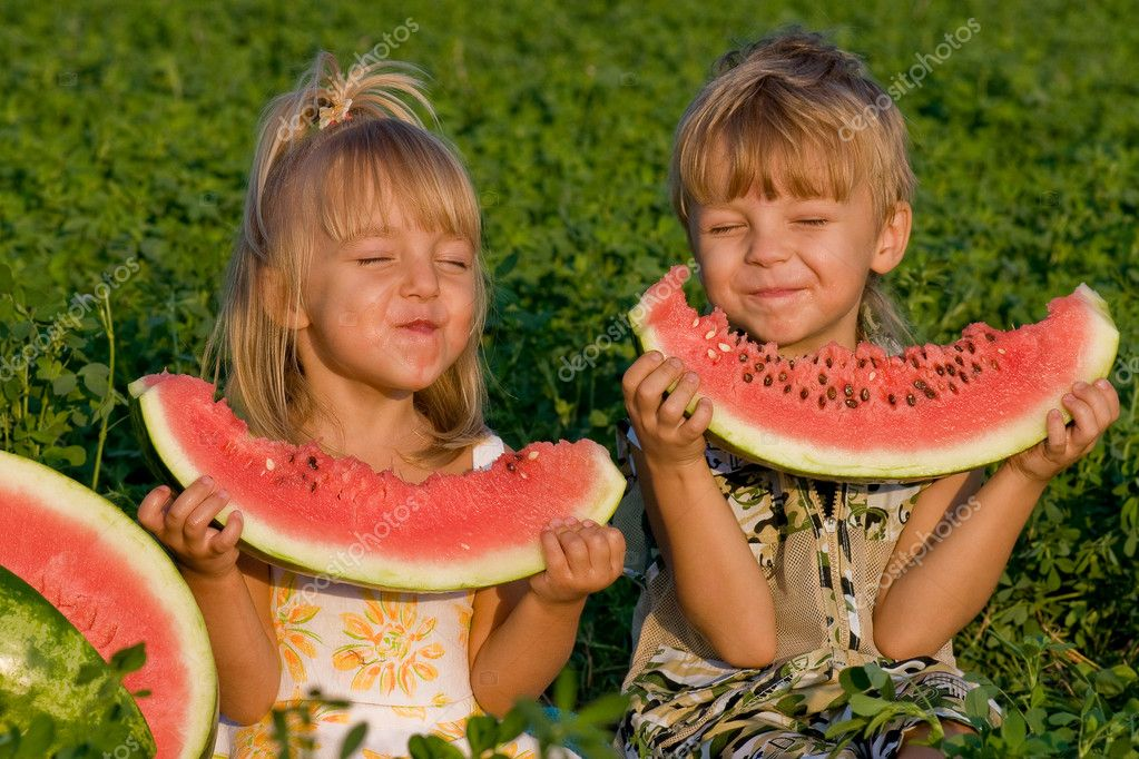 Little girl and boy with watermelon
