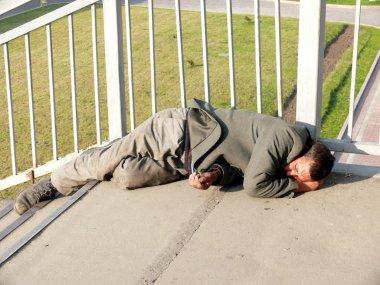Homeless alcoholic in the bridge