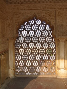 Intricate marble screen in Amber Fort,