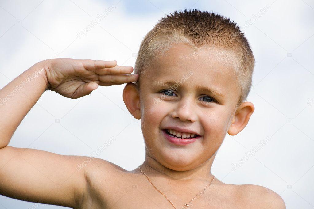 Saluting boy