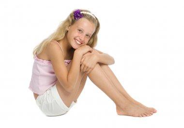 Pretty teenage girl sit on floor