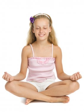 Young girl relaxes in a yoga pose