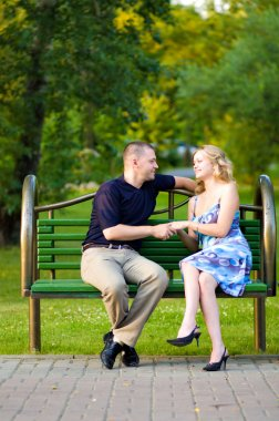 Couple in love sitting at a bench