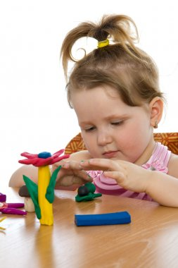 Girl playing with color play plasticine