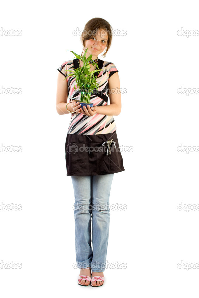 Young girl with home plant bamboo