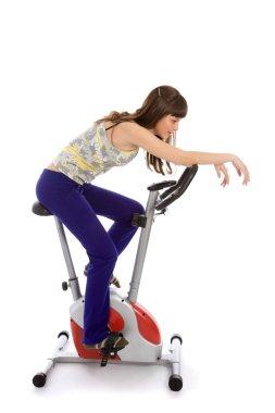 Teenager doing fitness on a bike