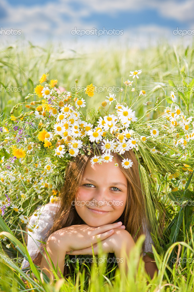 Young girl with camomile wreath on head