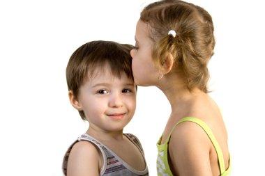 Little girl kisses little boy
