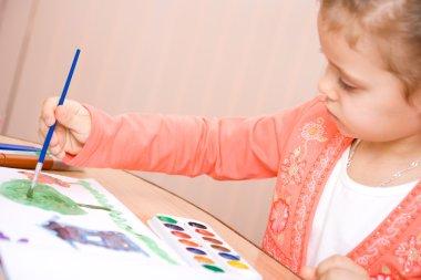 Pretty caucasian child watercolor paint