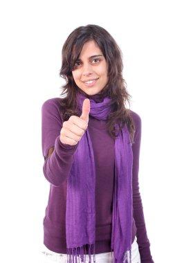 Young beautiful girl signaling thumbs up