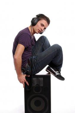 Dj in headphones standing in a speaker