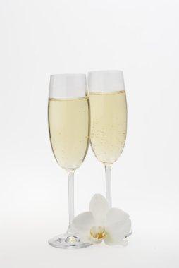 Glasses of champagne over white.