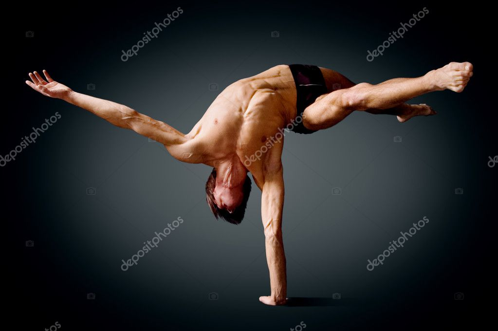 Circus actor standing on the hand