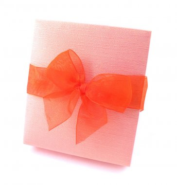 Gift in pink packing with red bow