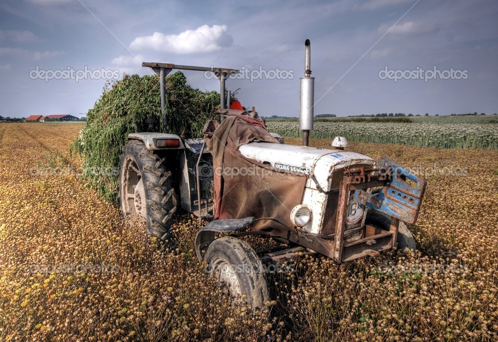 Hdr image of a tractor on farmland