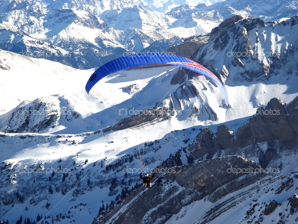 Paraglider above alps