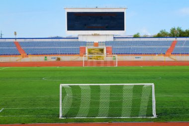 STADIUM field with goal and tablo