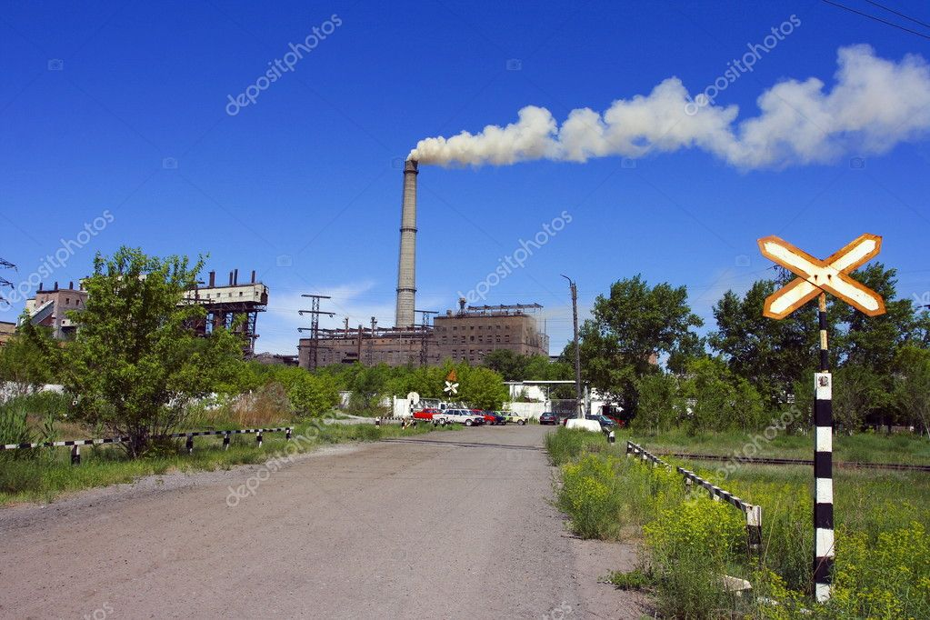 Plant with smoke and sign Stop on blue
