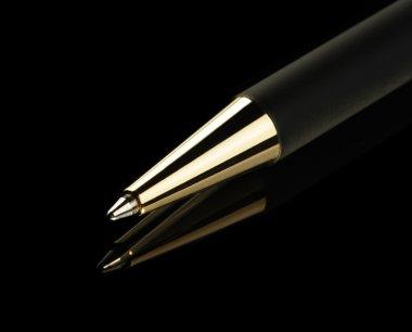 Black pen on a black background