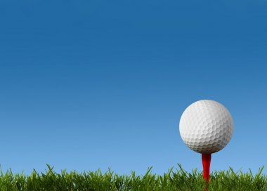 Ball for a golf on a green lawn