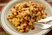 Scrambled eggs with tomato and bacon