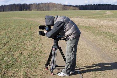A cameraman is shooting a film stock vector