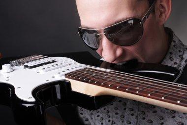 Rockstar holding a guitar