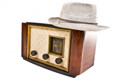 Old vintage radio with a hat