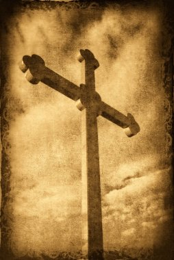 Grungy cross silhouette with clouds in t