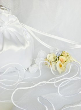Wedding flowers and bridal bag over veil