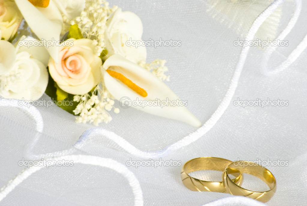 Wedding rings and flowers over veil Stock Photo Dessiebg 1574464