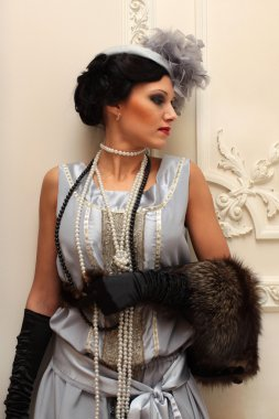 Beautiful girl in furs and pearls