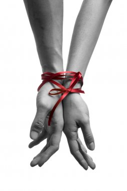Hands tieing with ribbon