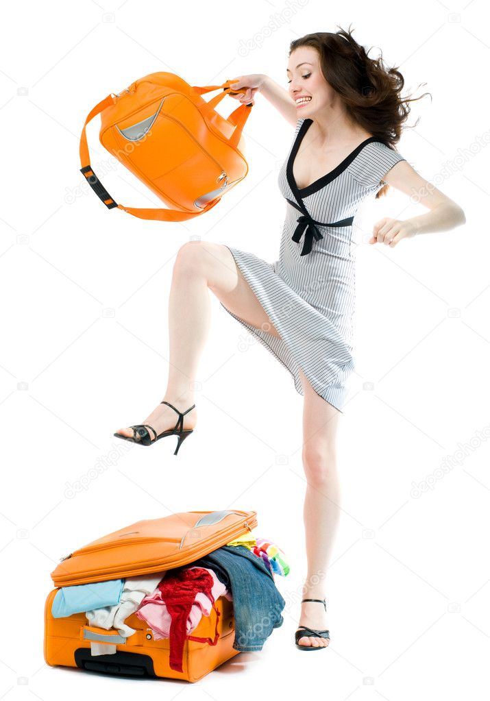 A beautyful girl is packing for travelling